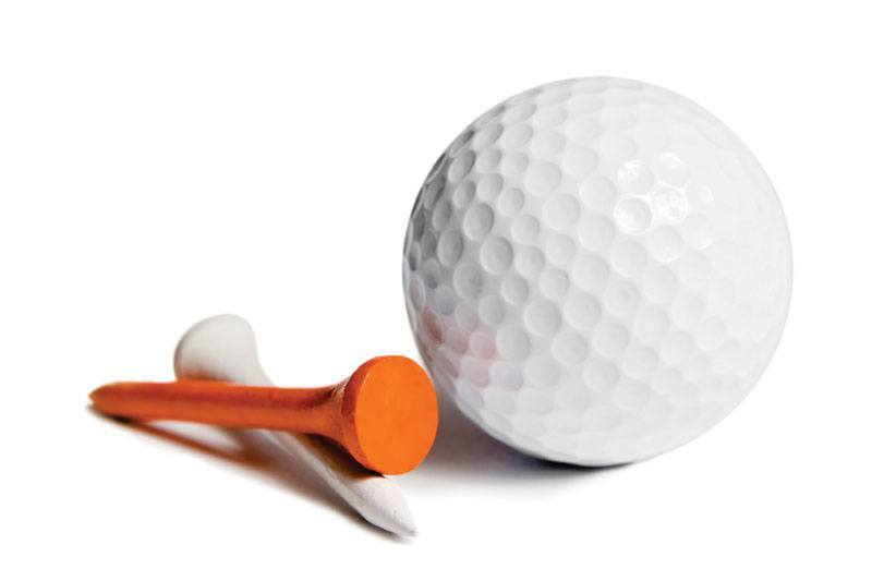 Golf ball and two tees, one white, one orange. Isolated on white.